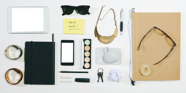 Overhead of business woman accessories.