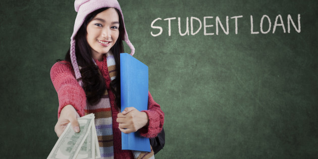 Pretty girl in a winter fashion offering money dollars for student loan in the classroom